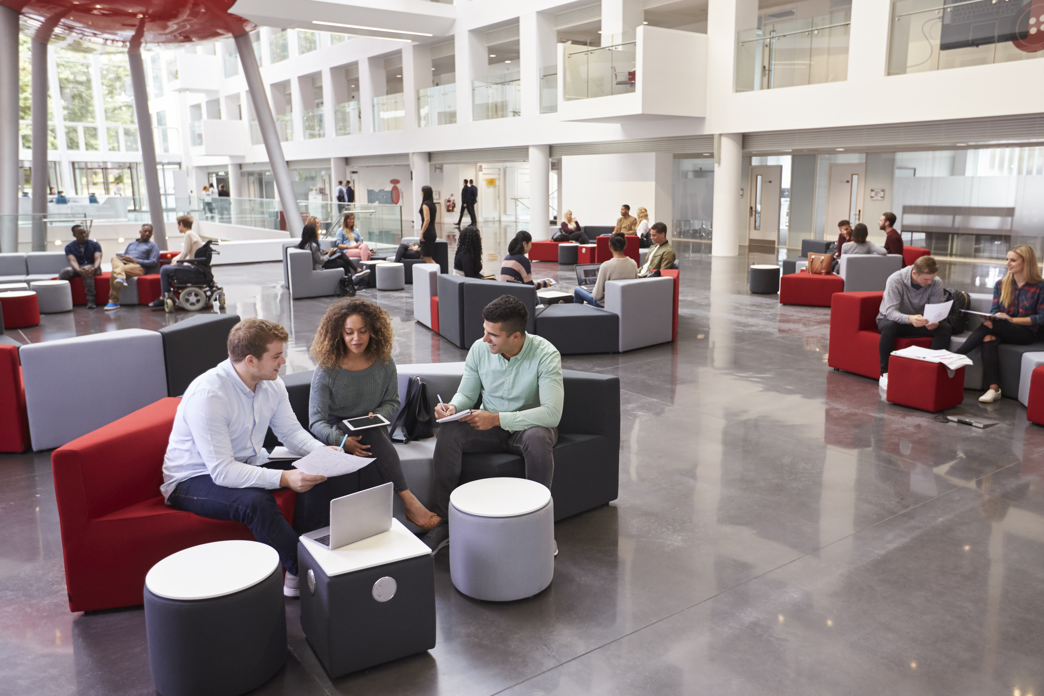 students-sitting-in-university-atrium-three-in-foregroundjpg